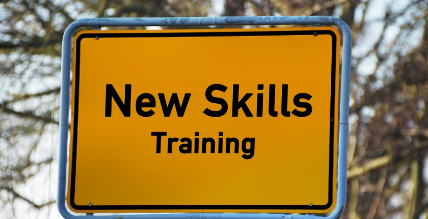 Road sign showing the words New Skills Training